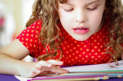 Cute little girl doing her homework Royalty Free Stock Photos