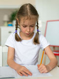 Cute little girl doing her homework. Royalty Free Stock Photography