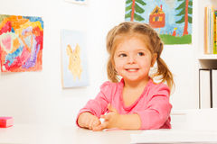 Cute little girl doing her lessons at the desk Royalty Free Stock Images
