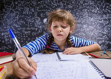 Cute little girl doing homework Royalty Free Stock Photography