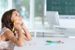 Cute little girl doing homework. At home Stock Images