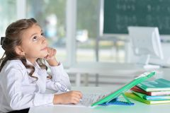 Cute little girl doing homework. At home Royalty Free Stock Photos