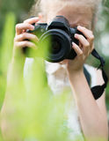 Cute little girl doing photographs. Royalty Free Stock Photography