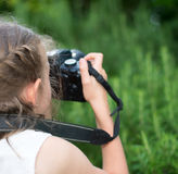 Cute little girl doing photographs. Stock Image