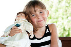 Cute Little Girl and Doll Stock Photography