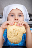 Cute little girl with a dough Stock Photos
