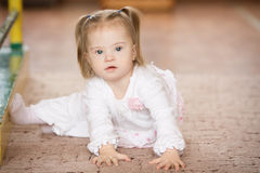 Cute little girl with Down syndrome. Cute little baby girl with Down syndrome Stock Photo