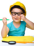 Cute little girl draw with marker wearing hard hat Stock Photo