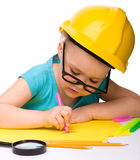 Cute little girl draw with marker wearing hard hat Royalty Free Stock Photos