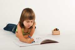 Cute little girl drawing Royalty Free Stock Images