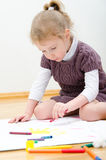 Cute little girl drawing Stock Images