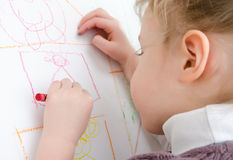 Cute little girl drawing Royalty Free Stock Image