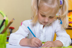 Cute little girl drawing Royalty Free Stock Photography