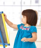 Cute little girl with drawing board Royalty Free Stock Images