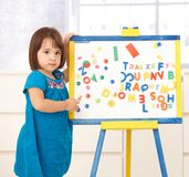 Cute little girl with drawing board Stock Images