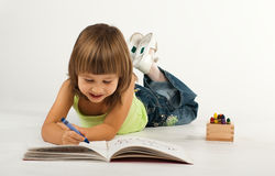 Cute little girl with drawing book Stock Photography