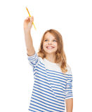 Cute little girl drawing with brush in the air Stock Photos