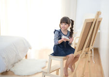 Cute little girl drawing on chalkboard Royalty Free Stock Images