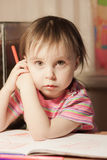 Cute little girl is drawing with felt-tip pen Royalty Free Stock Images