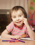 Cute little girl is drawing with felt-tip pen Stock Photos