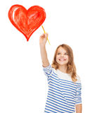 Cute little girl drawing heart with brush Royalty Free Stock Photography