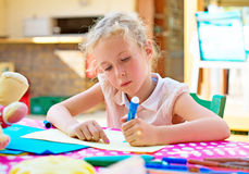 Cute little girl drawing. Stock Photo