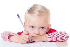 Cute little girl drawing with pencils Stock Photos