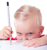 Cute little girl drawing with pencils Royalty Free Stock Image