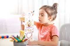 Cute little girl drawing with pencils at home royalty free stock images