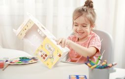 Cute little girl drawing with pencils at home royalty free stock photography