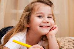 Cute little girl drawing with pencils. Stock Image