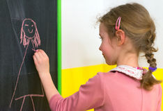 Cute little girl drawing. Stock Images