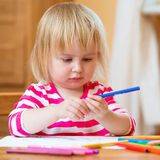 Cute little girl draws felt-tip pens Stock Photography