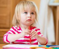 Cute little girl draws felt-tip pens Royalty Free Stock Images