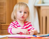 Cute little girl draws felt-tip pens Stock Photo