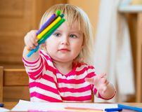 Cute little girl draws felt-tip pens Stock Photos