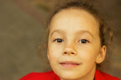 Cute little girl is dreaming stock photography