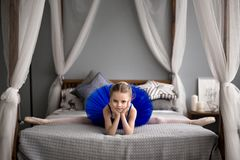Little girl dreams of becoming a ballerina. Royalty Free Stock Photo
