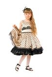 Cute little girl in a dress Stock Images