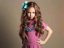 Cute little girl in a dress. beautiful child.colorful accessories Royalty Free Stock Photo