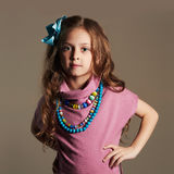 Cute little girl in a dress. beautiful child.colorful accessories Royalty Free Stock Photography