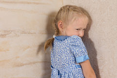 Cute Little Girl in Dress Isolated on Wooden Walls Stock Images