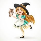 Cute little girl dressed as witch with a owl and magic wand Stock Photo