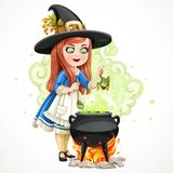 Cute little girl dressed as a witch throwing frog in the cauldron Stock Photos