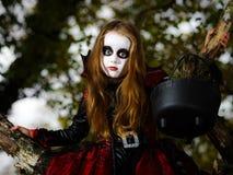 Cute little girl dressed in Halloween costume Stock Photo