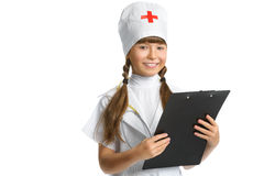 Cute little girl dressed like doctor looking at Stock Images
