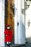 Cute little girl dressed in old-style coat posing on the street. Sunny day Royalty Free Stock Photography