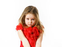 Cute little girl dressed in red posing in studio Stock Photos