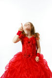 Cute little girl dressed in red posing in studio Royalty Free Stock Photos