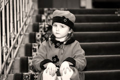 Cute little girl dressed in retro-style coat inside old house Royalty Free Stock Photos